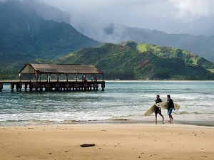 Surfer Dudes and Pier at Hanalei Bay Kauai Hawaii USA. Image shot 2009. Exact date unknown.